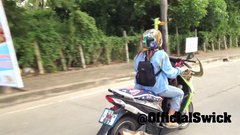 Thumbnail of Pet Parrot Flies Along with Lady on Scooter