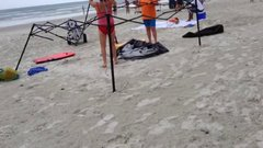 Thumbnail of Busted! Two women caught stealing a canopy on the beach, then attack!