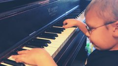 Thumbnail of 6 year old visually impaired piano player plays Bohemian Rhapsody