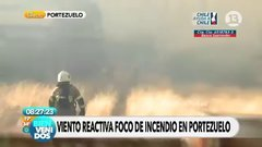 Thumbnail of Guy rushes to open up gate for fire fighters as wind rises a forest fire in Chile