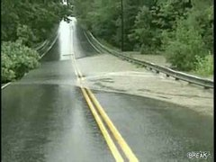 Thumbnail of Flooded river destroys road