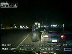 Thumbnail of Police officer versus Porsche